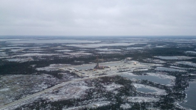 An aerial view shows an oil derrick and other facilities of an oilfield, part of the Imilorskoye group of fields, near the town of Kogalym