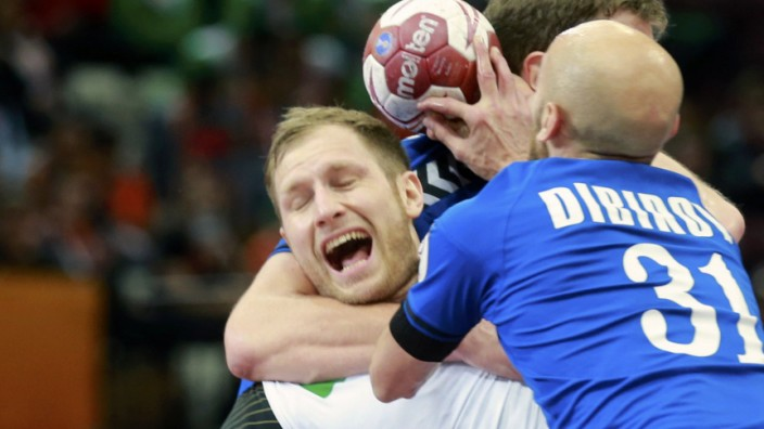 Weinhold of Germany is blocked by Dibirov and Evdokimov of Russia during their preliminary round of the 24th men's handball World Championship in Doha