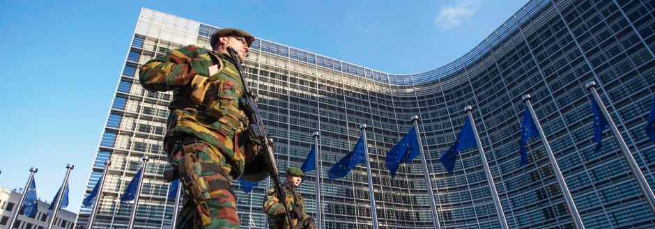 Belgian soldiers patrol outside the European Commission headquarters in central Brussels