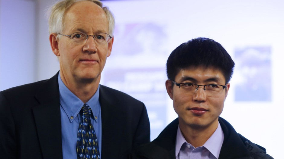 File photo of Blaine Harden, former Washington Post journalist, and Shin Dong-hyuk posing before a news conference to present their book 'Escape from Camp 14' in Paris