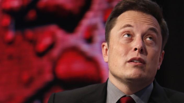 Tesla Motors CEO Musk talks at the Automotive World News Congress at the Renaissance Center in Detroit