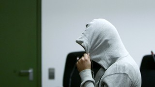 Defendant Harun P. arrives for start of trial in courtroom in Munich
