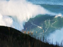 Nov 29 2014 Nazare Portugal SEBASTIAN STEUDTNER of Germany surfing a huge wave during a swell