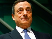 European Central Bank President Mario Draghi arrives for ECB news conference in Frankfurt