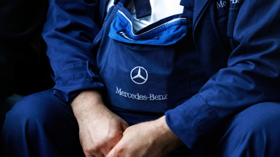 An employee of German car producer Daimler AG takes part in a warning strike by metal workers' union IG Metall in front of the Mercedes-Benz plant in Duesseldorf