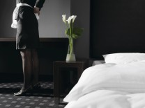 Germany Young woman dressed as maid in hotel room model released PUBLICATIONxINxGERxSUIxAUTxHUNxONL