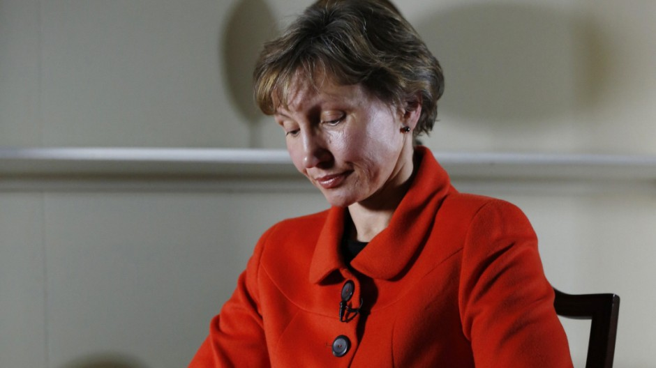 Marina Litvinenko, the wife of former KGB agent Alexander Litvinenko who was murdered in London in 2006, listens during an interview with Reuters in London