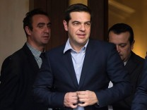 Newly appointed Greek Prime Minister and winner of the Greek parliamentary elections, Tsipras, walks with members of his cabinet in Athens