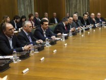Greek Prime Minister Alexis Tsipras (3rd L) attends the first meeting of the new cabinet in the parliament building in Athens