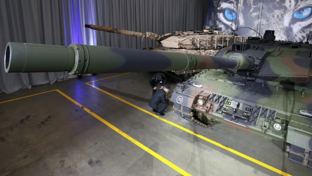German officers look at the new tank Leopard 2A7 by defence industry company Krauss-Maffei Wegmann (KMW) during the official handover to the German armed forces Bundeswehr in Munich