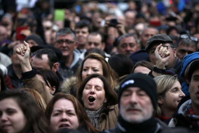 People take part in a rally called by Podemos at Madrid's Puerta del Sol landmark