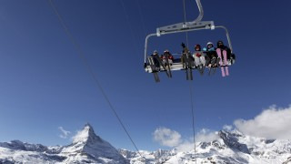 File photo of skiers pictured on a chair lift with Matterhorn mountain at Sunnegga in the ski resort of Zermatt