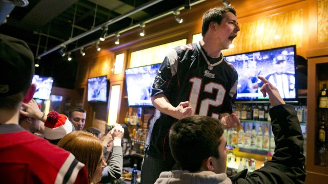 New England Patriots fans celebrate as the Super Bowl XLIX game clock winds down during their match against the Seattle Seahawks in Boston