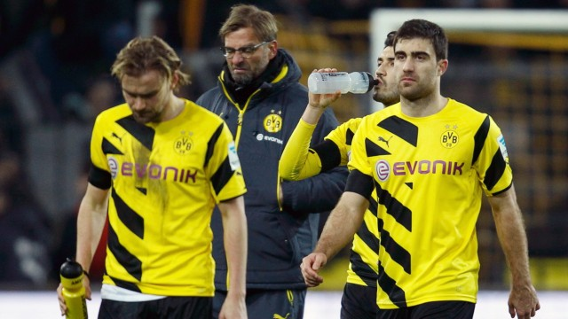 Borussia Dortmund players leave the pitch following their defeat by FC Augsburg in their Bundesliga soccer match in Dortmund