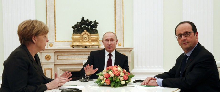 German Chancellor Merkel, Russia's President Putin and French President Hollande attend a meeting on resolving the Ukraine crisis at the Kremlin in Moscow