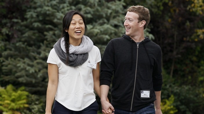 File photo of Facebook CEO Zuckerberg walking with wife Priscilla Chan at the annual Allen and Co. conference at the Sun Valley