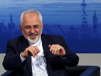 Iran's foreign minister Zarif gestures during an open debate during the 51st Munich Security Conference in Munich
