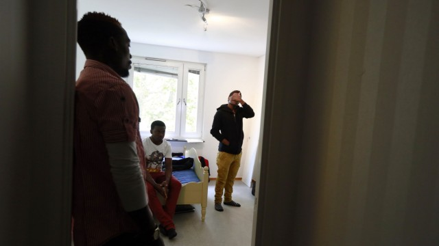 Edrisa Ssali, Katerega Musa, and Malik Douglas Darnba, from Uganda, are seen in the room they share in Sollentuna, a suburb of Stockholm