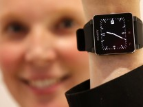 A model poses with a Sony SmartWatch 2 at the Sony booth during a media preview day at the IFA consumer electronics fair in Berlin