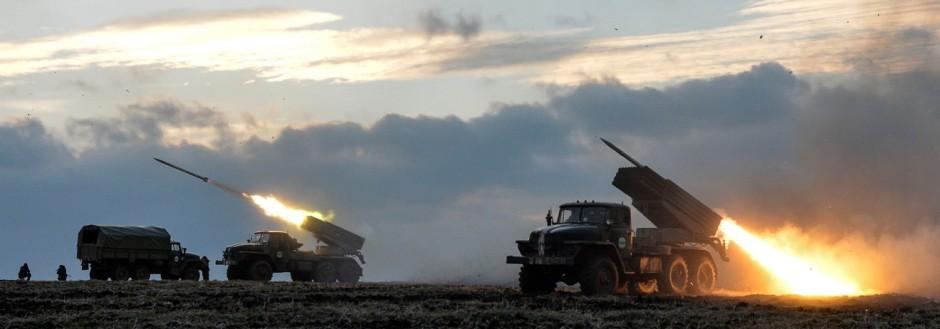 Ukrainian servicemen launch Grad rockets towards pro-Russian separatist forces outside Debaltseve, eastern Ukraine