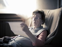 Senior woman reading a letter
