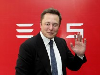 File photo of CEO of Tesla Motors Elon Musk waving during a news conference in Beijing