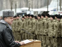 Handout picture of Poroshenko delivering a speech during his visit to the training center of the Ukrainian National Guard outside Kiev