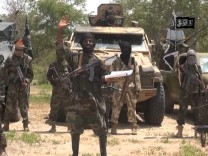 A screengrab taken on July 13, 2014 from a video released by the Nigerian Islamist extremist group Boko Haram and obtained by AFP shows the leader of the Nigerian Islamist extremist group Boko Haram,