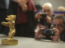 Media take pictures of Golden Bear for Best Film awarded to Iranian film director Panahi during news conference following 65th Berlinale International Film Festival in Berlin