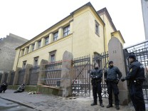 Police stand guard outside a synagogue in Krystalgade in Copenhagen