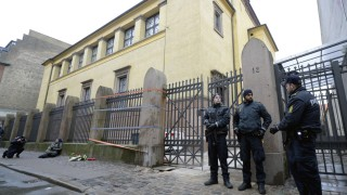 Police stand guard outside a synagogue in Krystalgade in Copenhagen