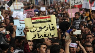 Iraqi Sunni Muslims take part in an anti-government demonstration in Ramadi
