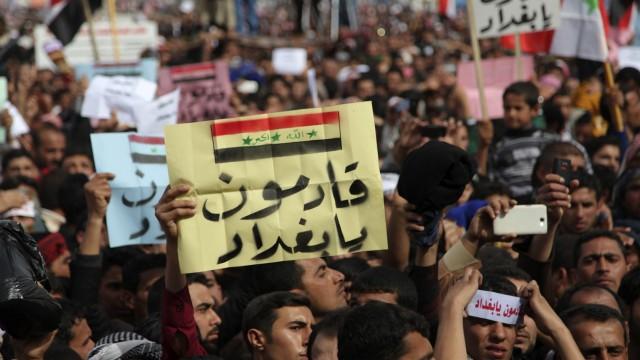 Iraqi Sunni Muslims take part in an anti-government demonstration in Ramadi