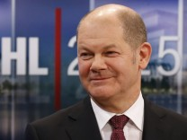 Social Democratic Party (SPD) top candidate, Hamburg Mayor Scholz smiles during a TV interview after the first exit polls in a state election in Hamburg
