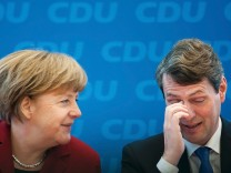 German Chancellor and head of CDU Merkel and her party's top candidate Wersich attend news conference at CDU headquarters in Berlin