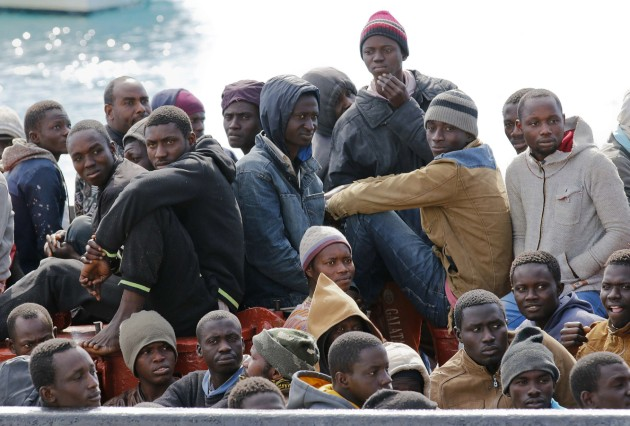 Migrants arrive by boat at the Sicilian harbour of Pozzallo