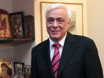 Greece's new president, Prokopis Pavlopoulos listens to the announcement that he was elected by a vote at the parliament on February 18, 2015 in his office in Athens. Greece's parliament elected pro-E