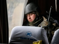 A Ukrainian serviceman who fought in Debaltseve is seen in a bus before leaving for his home, near Artemivsk
