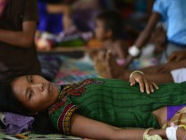 Patients undergo treatment for Malaria in India