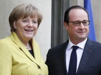 French President Francois Hollande Receives German Chancellor Angela Merkel At Elysee Palace