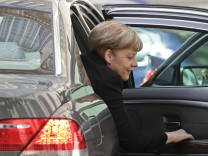 German Chancellor Angela Merkel exits a car as she arrives to meet Pope Francis at the Vatican