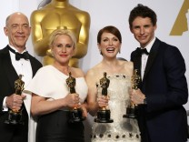 J.K. Simmons, Patricia Arquette, Julianne Moore and Eddie Redmayne pose with their Oscars backstage at the 87th Academy Awards in Hollywood, California