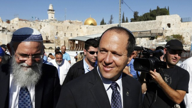 File photo of Jerusalem Mayor Nir Barkat walking after praying at the Western Wall in Jerusalem's Old City