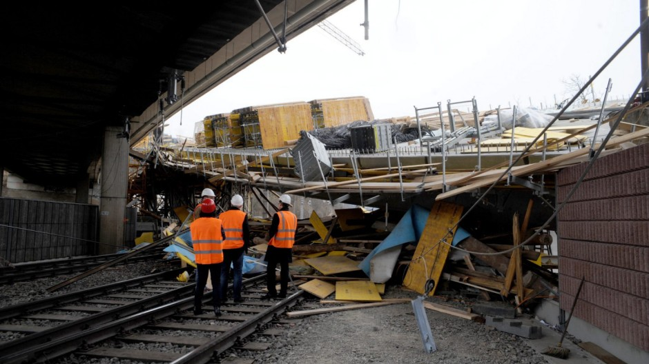 bridge under construction collapsed onto railway tracks beneath i