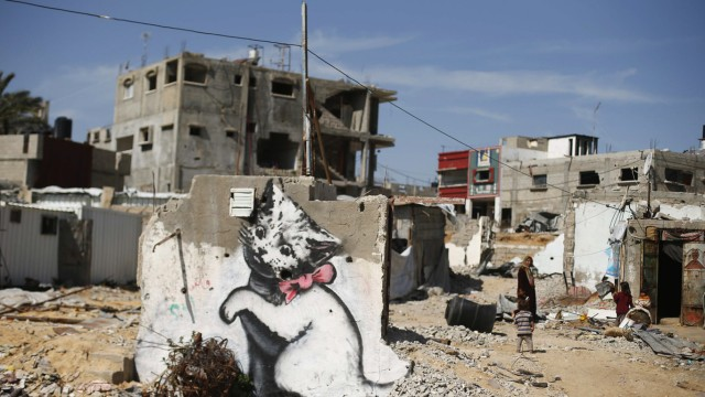 A mural of a kitten, presumably painted by British street artist Banksy, is seen on the remains of a house in Biet Hanoun