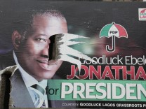 Nigeria postpones general election epa04621075 A picture made available on 15 February 2015 shows a campaign poster of incumbent presidential candidate, Goodluck Jonathan, torn apart on a street Corne
