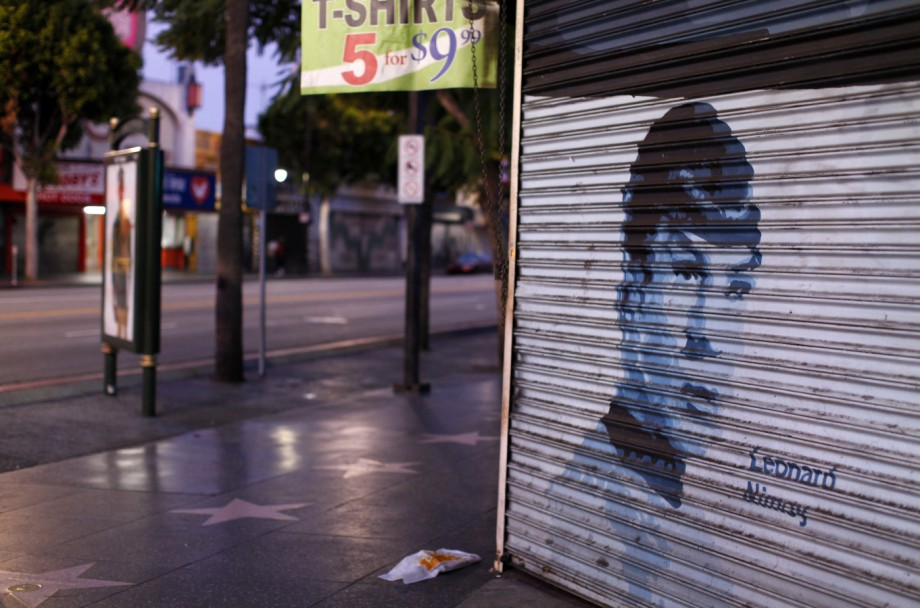 File photo of actor Leonard Nimoy's picture is painted on a storefront security gate along Hollywood Boulevard  in Hollywood, California