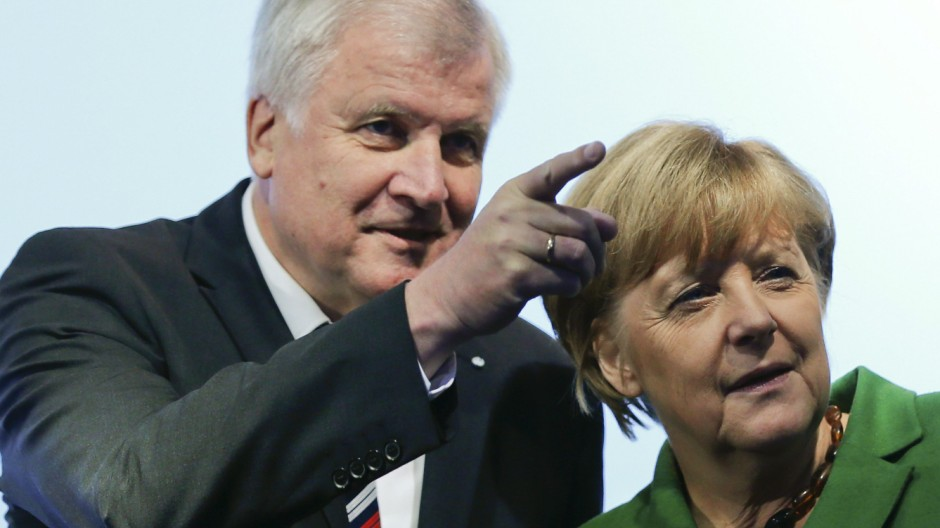 German Chancellor Merkel and Bavarian state Premier Seehofer arrive for a Christian Democratic Union election campaign meeting in Munich