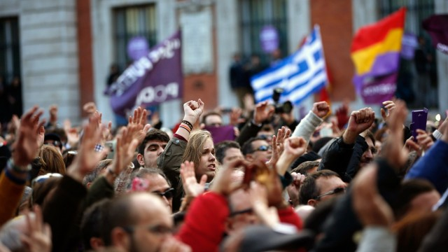 People take part in a rally called by Podemos, at Madrid's Puerta del Sol