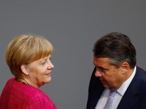 German Chancellor Merkel and Economy Minister Gabriel attend debate about situation in Iraq in lower house of parliament in Berlin
